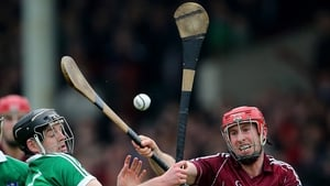 Limerick's Alan Dempsey and Niall Healy of Galway compete for a ball in the air