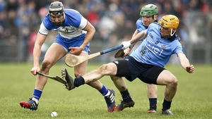 Darragh Fives of Waterford competes with Dublin's Paul Chute