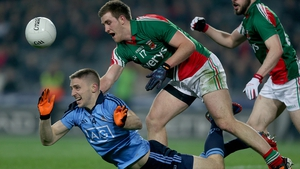 Eoghan O'Gara of Dublin falls under the tackle of Shane McHale