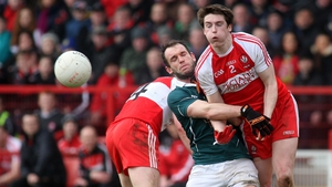 Gareth McKinless of Derry and Kildare's Darroch Mulhall battle for the ball