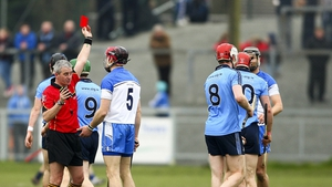 Referee Johnny Ryan shows Waterford's Shane O'Sullivan a red card