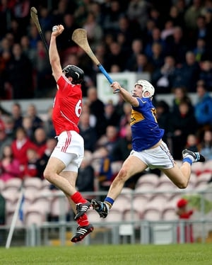 Christopher Joyce of Cork and Niall O'Meara compete for the ball