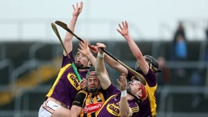 Wexford and Kilkenny players await a dropping ball in their Allianz League meeting at Wexford Park