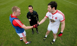 Michael Shields and Sean Cavanagh with referee David Coldrick at the coin toss