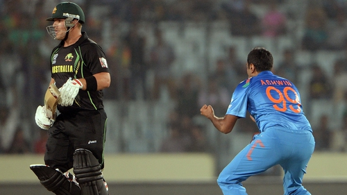 India bowler Ravichandran Ashwin celebrates after taking the wicket of Australia's Aaron Finch