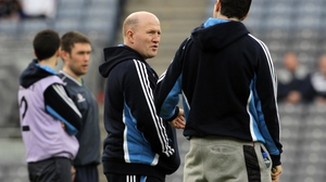 Michael Carruth acts as a masseur to Anthony Daly's side
