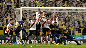 Juan Román Riquelme scores for Boca Juniors in the 'El Superclasico' against Buenos Aires rivals River Plate