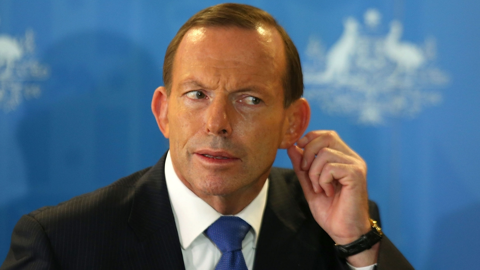 Australian Prime Minister Tony Abbott listens to a question at a news conference about the search for Malaysian Airlines Flight MH370