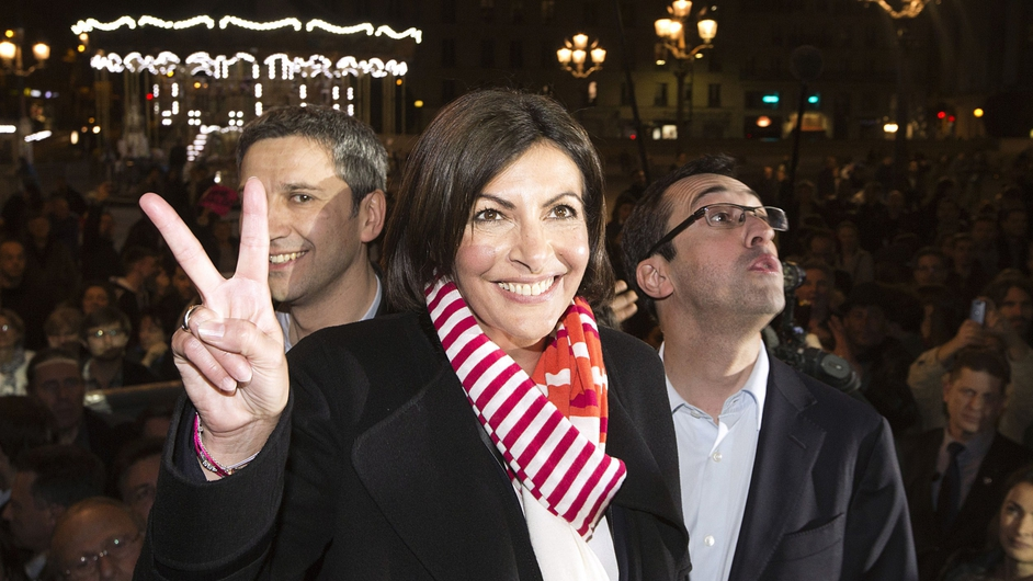 Newly elected French Socialist party mayor of Paris Anne Hidalgo flashes a victory sign