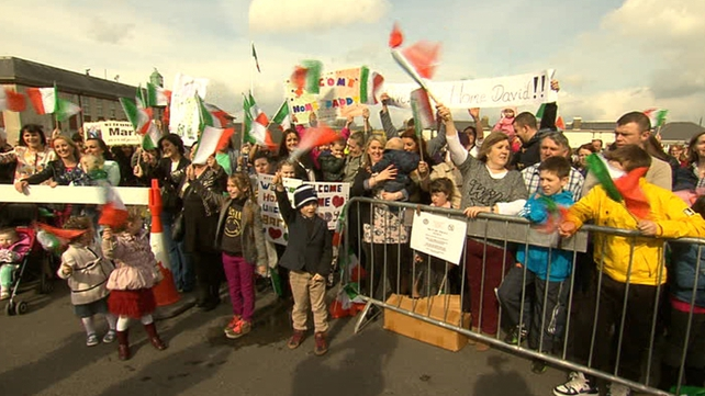 Families waited in the sunshine for the troops to return