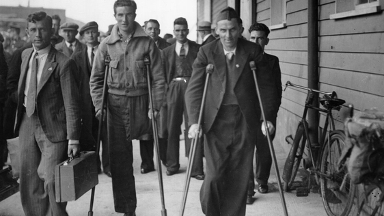 Irish volunteers injured during the Spanish Civil War arrive back in Dublin.