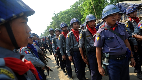 Burmese police provide security during census taking in the village of Theechaung in western Burma
