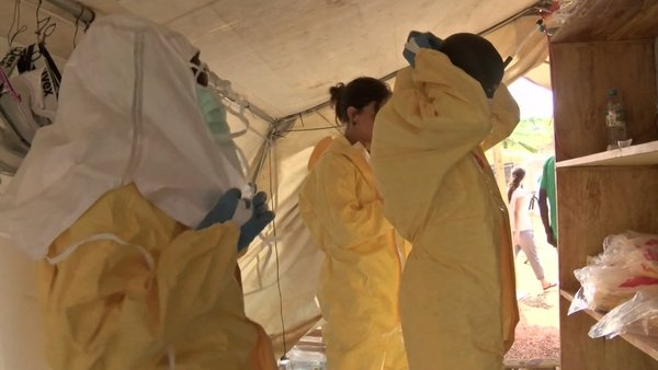 Guinea's government raised the death toll in the Ebola epidemic raging through its southern forests and capital to 95