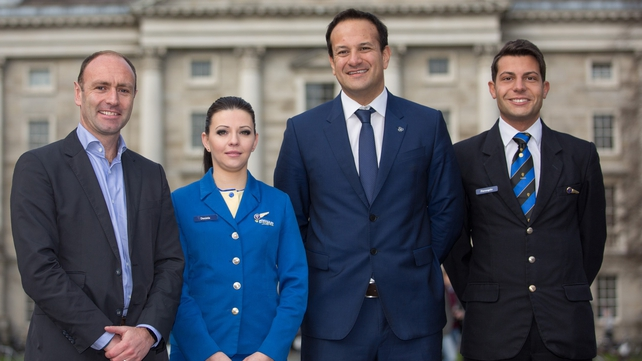 Ryanair chief marketing officer Kenny Jacobs, cabin crew member Daniela Sopkova, Transport Minister Leo Varadkar and cabin crew member Federico Galli