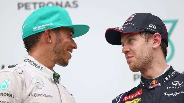 Sebastian Vettel (r) on the podium in Malaysia last Sunday with winner Lewis Hamilton