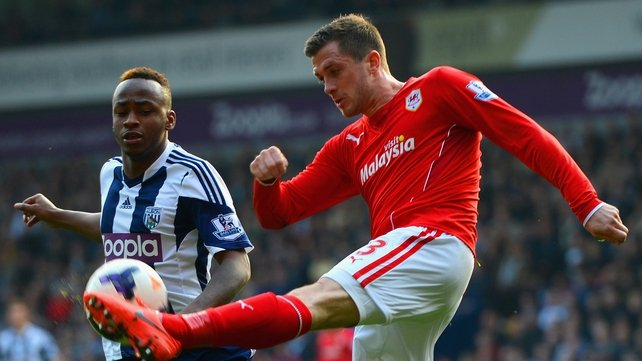 Saido Berahino challenges Cardiff's Andrew Taylor during the game