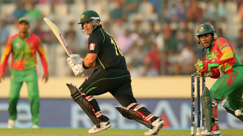 Aaron Finch hits a boundary for Australia against Bangladesh