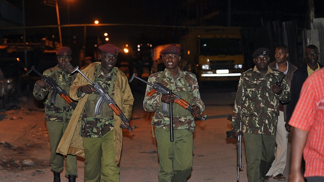 Kenyan paramilitary police arrive at the scene of the explosion in an area often known as Little Mogadishu