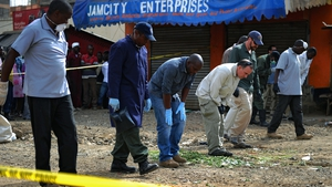Forensic experts search for evidence at the scene of the explosion