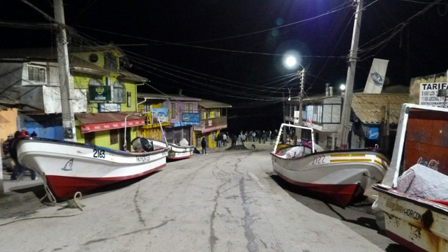 Fishing boats rest on a road after they were removed from the water due to the tsunami alert (Pic: EPA)