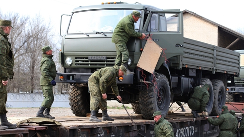 Russian troops unload military trucks in Simferopol in Crimea