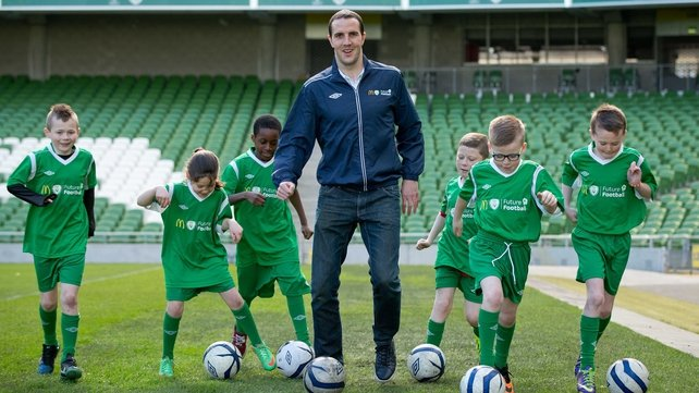 John O'Shea with children from Corduff FC at the launch of the FAI's Future Football 2014 initiative at the Aviva stadium