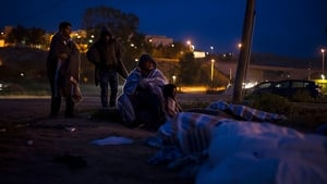 Syrian refugees try to sleep outside the Centre for Temporary Stay of Immigrants (CETI) in Melilla, Spain