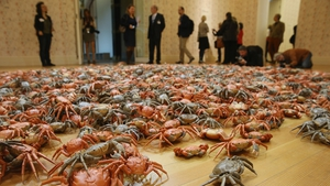 Visitors look at the work 'He Xie', or 'Crabs', at the 'Evidence' exhibition by Chinese artist Ai Weiwei in Berlin, Germany