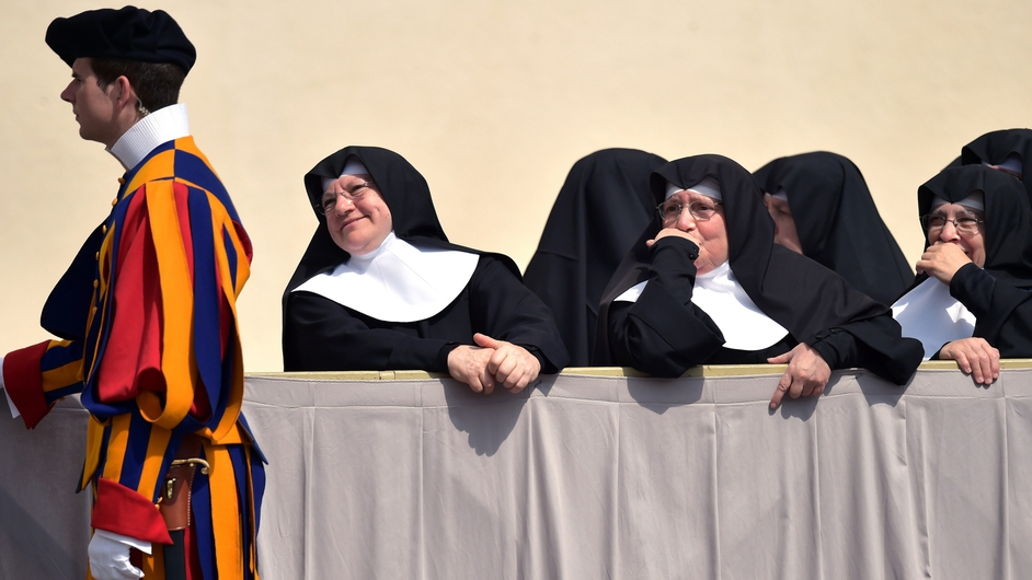 Nuns stand at St Peter's square at the Vatican at the end of the Pope's weekly general audience