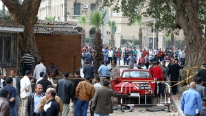 Egyptian security officers and people inspect the scene of the explosion near Cairo University (Pic: EPA)