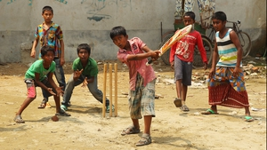 Local children play street cricket in the suburbs of Dhaka during the ICC World Twenty20 in Bangladesh