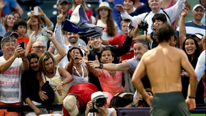 Rafael Nadal of Spain throws his towel into the crowd after his match against Denis Istomin of Uzebekistan during the Sony Open in Key Biscayne, Florida