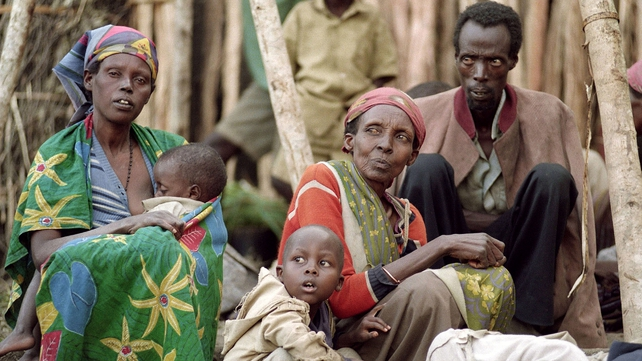 Displaced Tutsis rest in May 1994 at a refugee camp in Kabgayi. 14,000 refugees took shelter in this camp and got food every three days