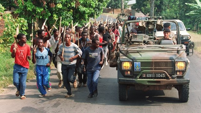 French soldiers on patrol pass ethnic Hutu troops from the Rwandan government forces in June 1994, near the border with Zaire