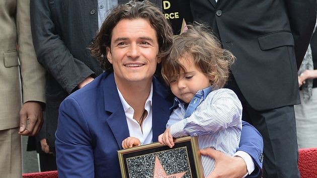 Orlando Bloom with his son Flynn as he receives a star on the Hollywood Walk of Fame