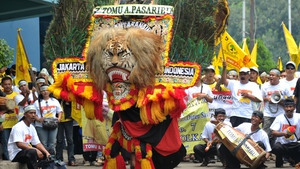 Supporters of Golkar party perform traditional Reog dance during a campaign rally ahead of legislative elections in Jakarta, Indonesia
