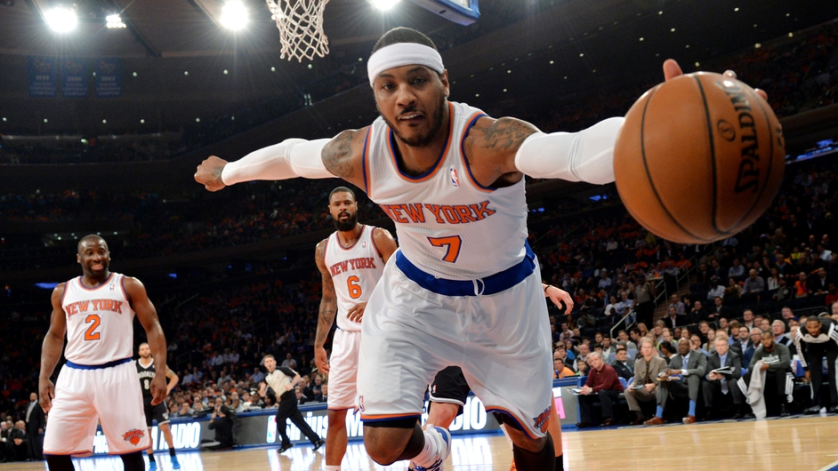 The Knicks' Carmelo Anthony (R) grabs a loose ball during the first half of the NBA game between the New York Knicks and the Brooklyn Nets at Madison Square Garden in New York
