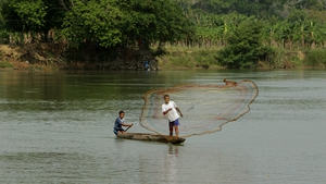 Youths fishing on Sinu river, Colombia (Pic: EPA)