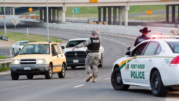 Military police direct traffic outside Fort Hood military base (Pic: EPA)