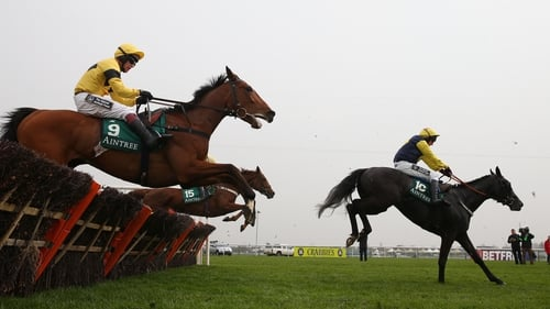 Paul Carberry and Guitar Peter jump the last in front en route to winning the Aintree opener