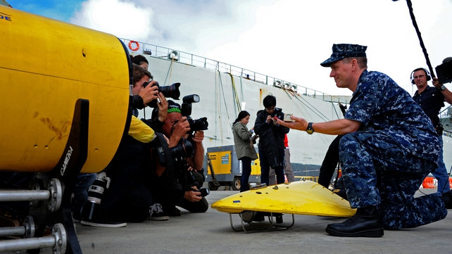A US Navy Captain demonstrates how the towed array listens for the signal emitted by a locator beacon (Pic: EPA)