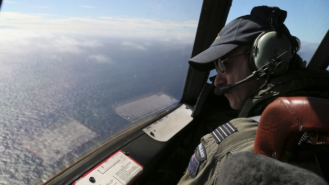A Royal New Zealand Air Force P3 Orion captain looks out of the window while searching for MH370