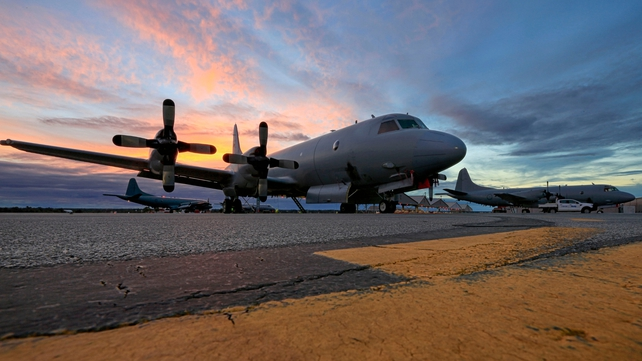 The sun sets over a line up of AP-3C Orion's at the Royal Australian Air Force Pearce air base after a search over the southern Indian Ocean (Pic: EPA)