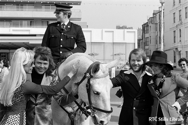 ABBA pose with a mounted policeman (1974)