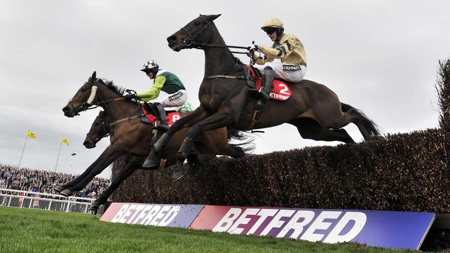 Boston Bob's (near side) powered away from Rolling Aces and Ballynagour after the last to earn jockey Paul Townend and trainer Willie Mullins their first wins in the Melling Chase