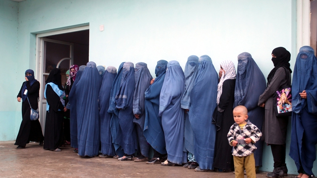 Women queue up outside a polling station as they wait to cast their ballots (Pic: EPA)