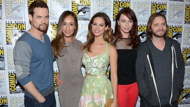 Aaron Stanford (right) with Nikita co-stars at the 2012 Comic-Con