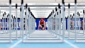 Brett Watton of Queensland gets set to run in the 110m hurdles during the Australian Athletics Championships at Olympic Park in Melbourne