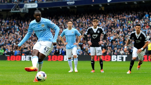 Yaya Toure gives Man City an early lead from the penalty spot