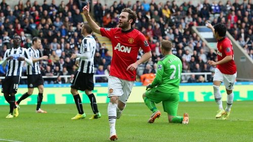 Juan Mata celebrates after scoring his second goal